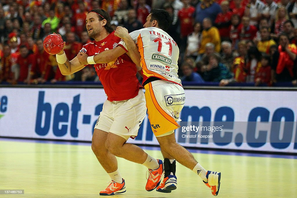 Vladimir Temelkov of Macedonia (R) defends against Thpomas Mogensen of Denmark during the Men's European Handball Championship second round group one match between Denmark and Macedonia at Beogradska Arena on January 21, 2012 in Belgrade, Serbia.