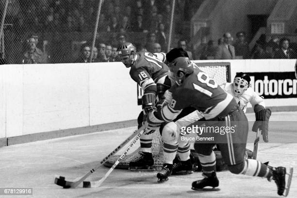 Vladimir Vikulov and Vladimir Petrov of the Soviet Union go for the puck as goalie Tony Esposito of Canada defends the net during a game against the...