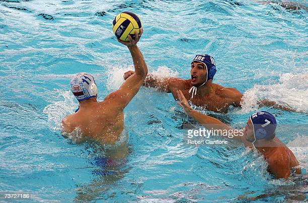 Vladimir Vujasinovic of Serbia looks to throw the ball during the Men's Quarter Final Round Water Polo match between Serbia and Greece at the...