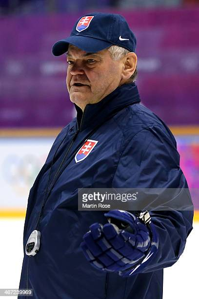 Vladimir Vujtek head coach of Slovakia looks on prior to their Men's Ice Hockey practice session ahead of the Sochi 2014 Winter Olympics at the...
