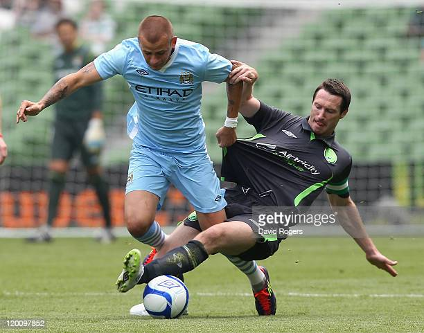 Vladimir Weiss of Manchester City is tackled by Barry Malloy during the Dublin Super Cup match between Manchester City and Airtricity XI at Aviva...