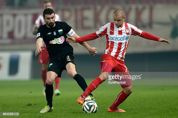 Vladimir Weiss of Olympiacos fights for the ball with Thanasis Moulopoulos of Levadiakos during the Greek Superleague match between Olympiacos and...