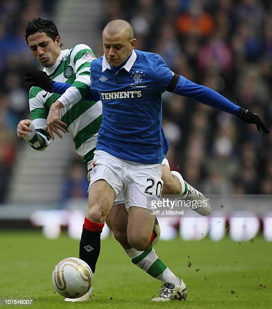 Vladimir Weiss of Rangers tackles Baram Kayal of Celtic during the Clydesdale Bank Premier League match between Rangers and Celtic at Ibrox Stadium...