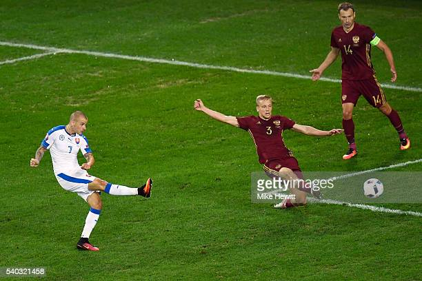 Vladimir Weiss of Slovakia scores the opening goal during the UEFA EURO 2016 Group B match between Russia and Slovakia at Stade Pierre-Mauroy on June...