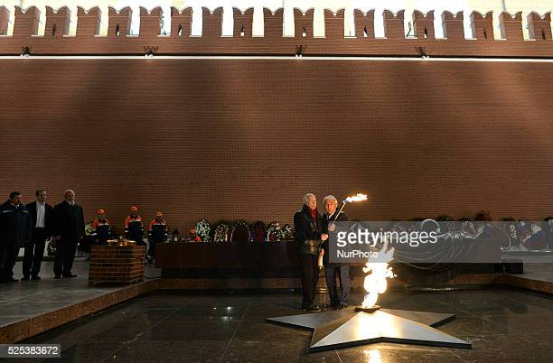 Vladimir Zeldin a Russian theatre and cinema actor and Gasan Gadyiev MosGaz light the flame at the Tomb of the Unknown Soldier after MosGaz cleaned...