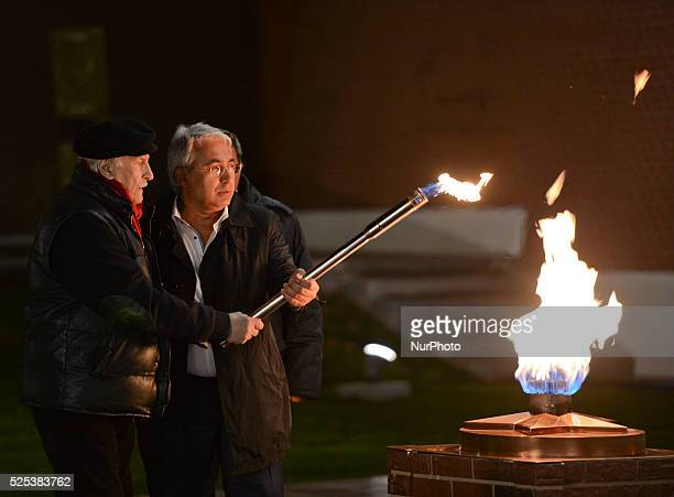 Vladimir Zeldin a Russian theatre and cinema actor lights the flame at the Tomb of the Unknown Soldier as MosGaz is cleaning and preparing the gaz...
