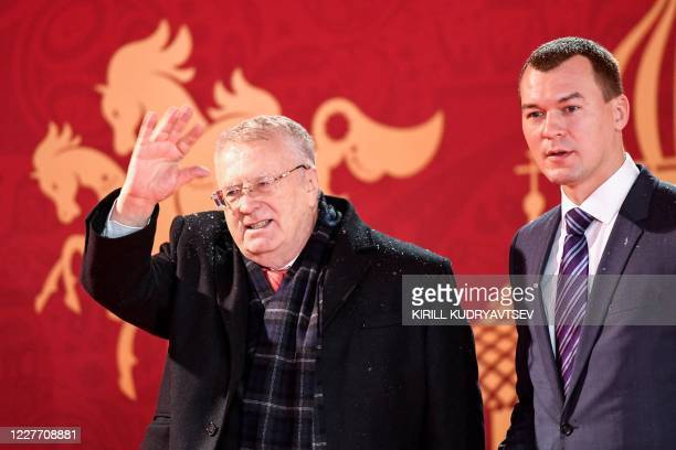 Vladimir Zhirinovsky, leader of the Liberal Democratic Party of Russia , and LDPR party lawmaker Mikhail Degtyarev arrive to attend the Final Draw...