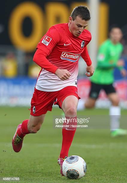 Vladimr Darida of Freiburg runs with the ball during the Bundesliga match between SC Freiburg and Hannover 96 at MAGE SOLAR Stadium on December 21...