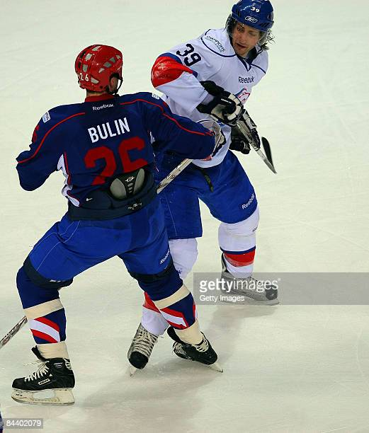 Vladislav Bulin of Metallurg Magnitogorsk challenges Mark Bastl of ZSC Lions Zurich during the IIHF Champions Hockey League final game between...