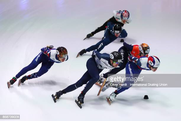 Vladislav Bykanov of Israel and Denis Ayrapetyan of Russia competes in the Mens1500m final B race during the Audi ISU World Cup Short Track Speed...