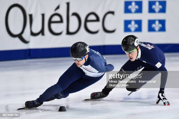 Vladislav Bykanov of Israel competes against Pierre Boda of Australia in the men's 1500 meter heats during the World Short Track Speed Skating...