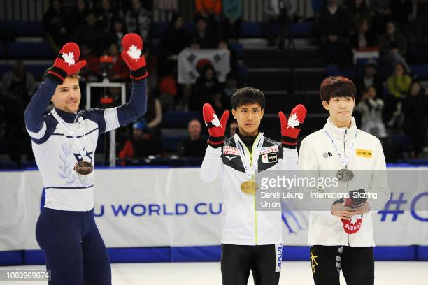 Vladislav Bykanov of Israel Kazuki Yoshinaga of Japan and Lee June Seo of Korea wave to the crowd with their medals after placing in the 1500m men's...