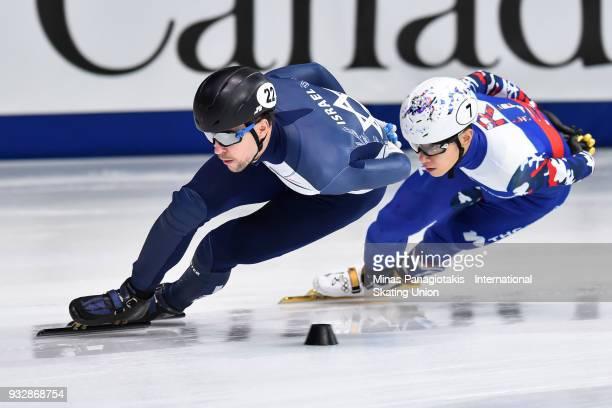 Vladislav Bykanov of Israel skates against Victor An of Russia in the men's 1500 meter heats during the World Short Track Speed Skating Championships...
