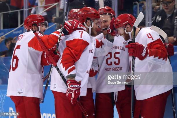 Vladislav Gavrikov of Olympic Athlete from Russia celebrates with teammates after scoring his team's second goal in the second period against Czech...