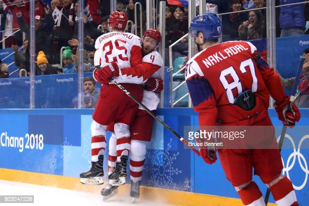 Vladislav Gavrikov of Olympic Athlete from Russia celebrates with Mikhail Grigorenko after scoring his team's second goal in the second period...