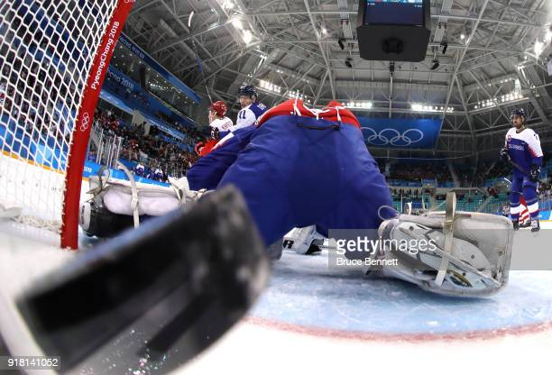Vladislav Gavrikov of Olympic Athlete from Russia shoots and scores against Branislav Konrad of Slovakia in the first period during the Men's Ice...