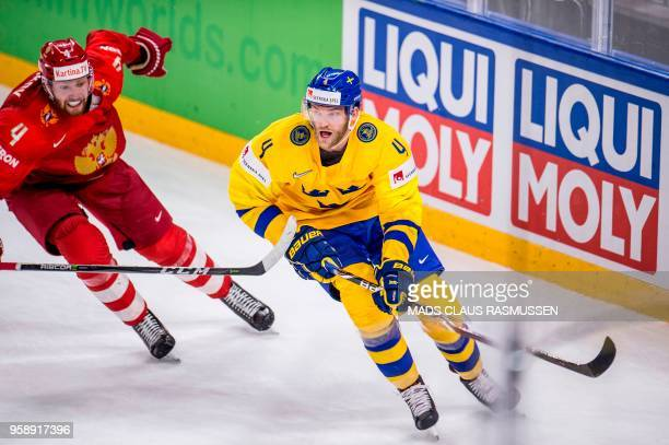 Vladislav Gavrikov of Russia and Mattias Ekholm of Sweden vie during the group A match Russia v Sweden of the 2018 IIHF Ice Hockey World Championship...