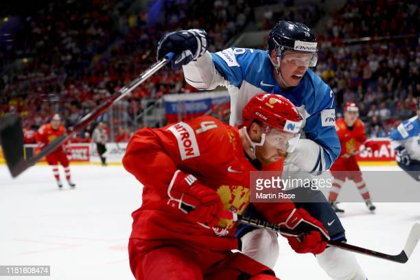 Vladislav Gavrikov of Russia challenges Jere Sllinen of Finland during the 2019 IIHF Ice Hockey World Championship Slovakia semi final game between...