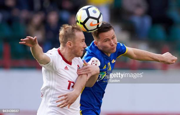 Vladislav Ignatyev of FC Lokomotiv Moscow and Aleksandr Sapeta of FC Rostov Rostov-on-Don vie for the ball during the Russian Football League match...