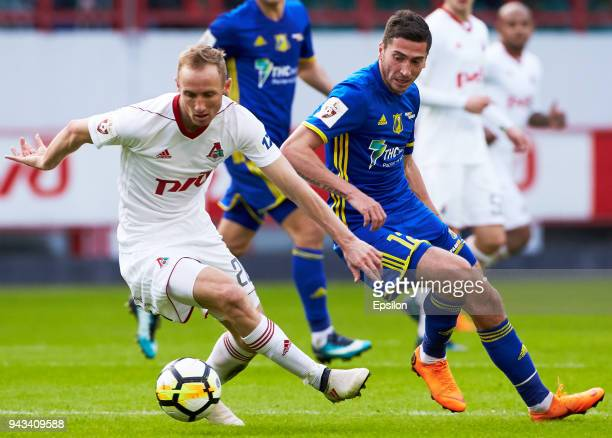 Vladislav Ignatyev of FC Lokomotiv Moscow and Aleksei Ionov of FC Rostov Rostov-on-Don vie for the ball during the Russian Football League match...