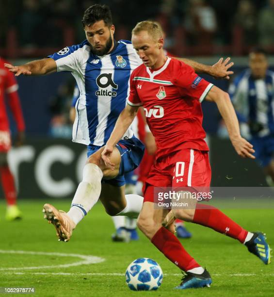 Vladislav Ignatyev of FC Lokomotiv Moscow and Felipe of FC Porto vie for the ball during the Group D match of the UEFA Champions League between FC...