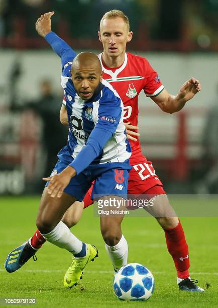 Vladislav Ignatyev of FC Lokomotiv Moscow and Yacine Brahimi of FC Porto vie for the ball during the Group D match of the UEFA Champions League...