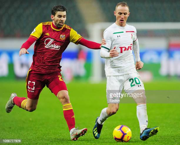 Vladislav Ignatyev of FC Lokomotiv Moscow vies for the ball with Victor Alvarez of FC Arsenal Tula during the Russian Premier League match between FC...