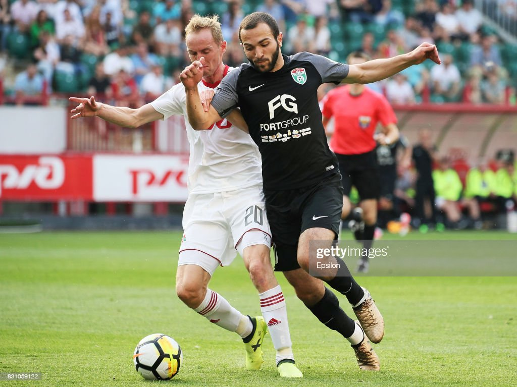 Vladislav Ignatyev of FC Lokomotiv Moscow vies for the ball with Georgi Melkadze of FC Tosno Khabarovsk during the Russian Premier League match between FC Lokomotiv Moscow and FC Tosno at Lokomotiv stadium on August 13, 2017 in Moscow, Russia.