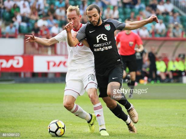 Vladislav Ignatyev of FC Lokomotiv Moscow vies for the ball with Georgi Melkadze of FC Tosno Khabarovsk during the Russian Premier League match...