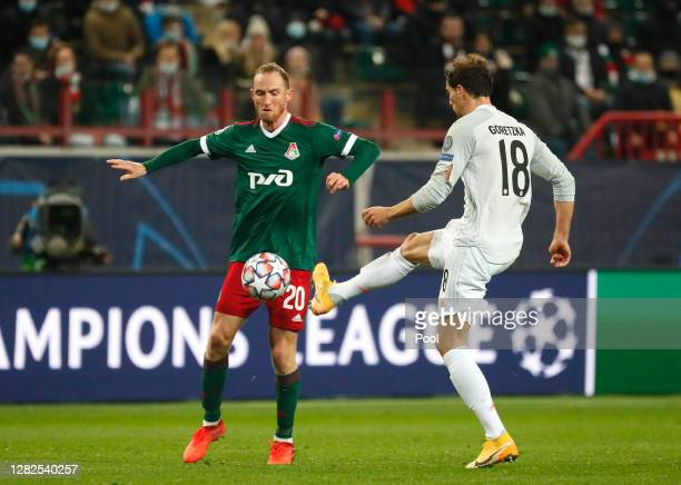 Vladislav Ignatyev of Lokomotiv Moscow battles for possession with Leon Goretzka of Bayern Munich during the UEFA Champions League Group A stage...