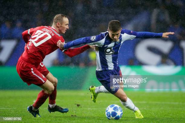 Vladislav Ignatyev of Lokomotiv Moscow, Otavio Edmilson of Porto during the UEFA Champions League match between FC Porto v Lokomotiv Moscow at the...
