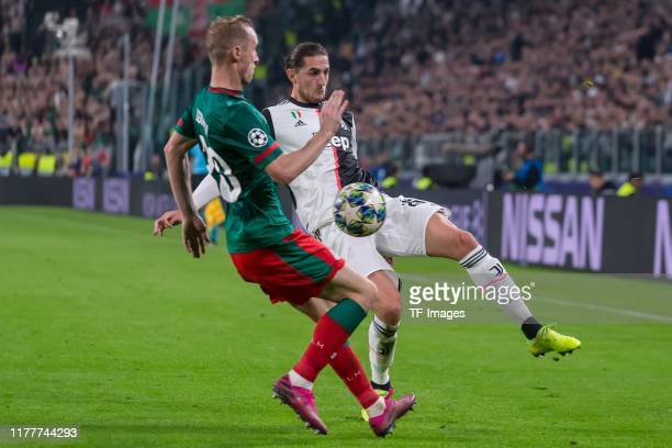 Vladislav Ignatyev of Lokomotiv Moskva and Adrien Rabiot of Juventus Turin battle for the ball during the UEFA Champions League group D match between...
