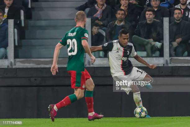 Vladislav Ignatyev of Lokomotiv Moskva and Alex Sandro of Juventus Turin battle for the ball during the UEFA Champions League group D match between...