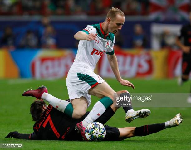 Vladislav Ignatyev of Lokomotiv Moskva and Joao Felix of Atletico Madrid vie for the ball during the UEFA Champions League group D match between...
