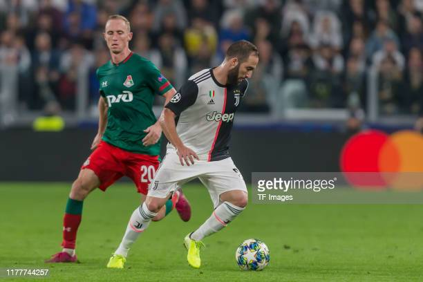 Vladislav Ignatyev of Lokomotiv Moskva and Leonardo Bonucci of Juventus Turin battle for the ball during the UEFA Champions League group D match...