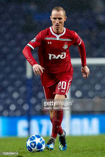 Vladislav Ignatyev of Lokomotiv runs with the ball during the Group D match of the UEFA Champions League between FC Porto and FC Lokomotiv Moscow at...