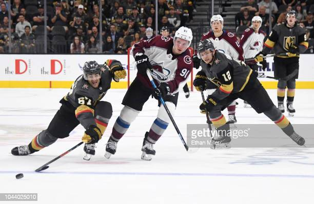 Vladislav Kamenev of the Colorado Avalanche shoots an emptynet goal between Max Pacioretty and Erik Brannstrom of the Vegas Golden Knights in the...