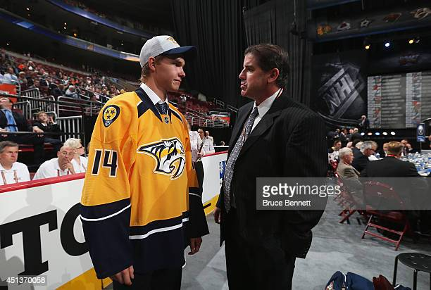 Vladislav Kamenev speaks with Head Coach Peter Laviolette after being selected by the Nashville Predators on Day Two of the 2014 NHL Draft at the...