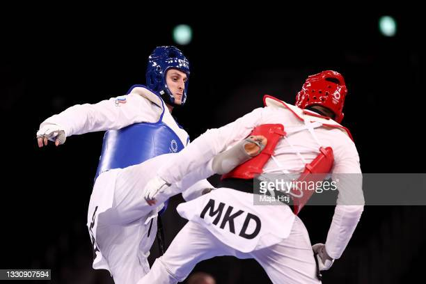Vladislav Larin of Team ROC competes against Dejan Georgievski of Team North Macedonia during the Men's +80kg Taekwondo Gold Medal contest on day...