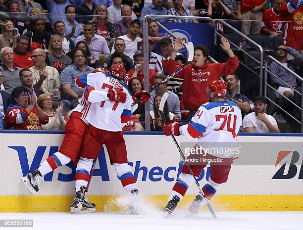 Vladislav Namestnikov celebrates with Ivan Telegin and Alexei Emelin of Team Russia after scoring a second period goal on Team North America during...