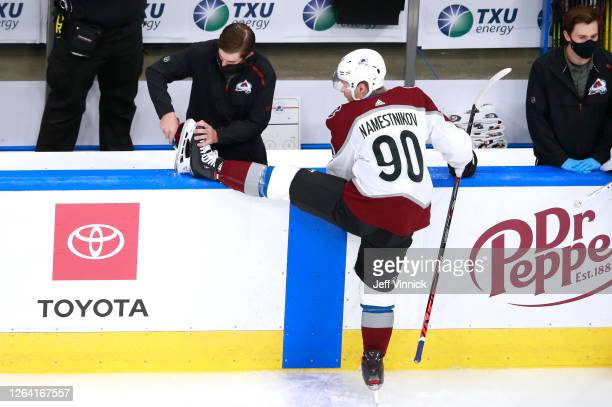 Vladislav Namestnikov of the Colorado Avalanche has his skate adjusted during warm ups before the game against the Dallas Stars in a Western...