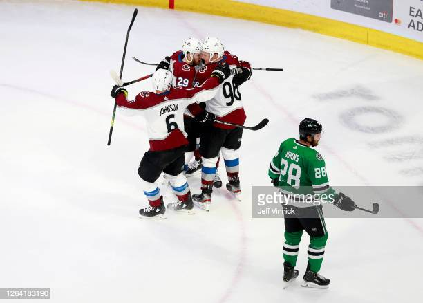 Vladislav Namestnikov of the Colorado Avalanche is congratulated by teammates Erik Johnson and Nathan MacKinnon after he scored a goal in the second...