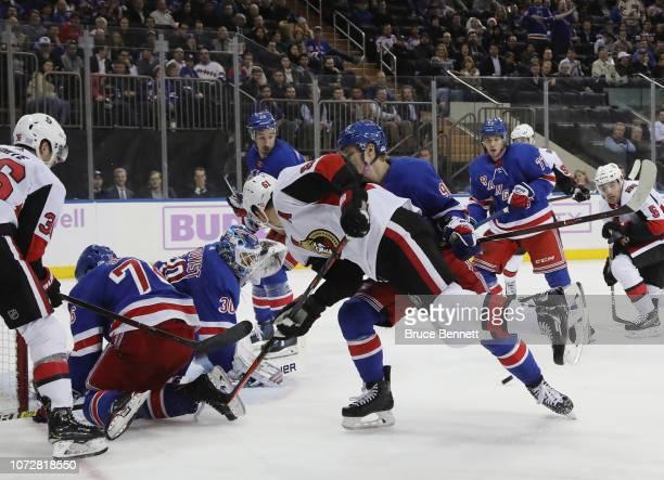 Vladislav Namestnikov of the New York Rangers checks Mark Stone of the Ottawa Senators during the third period at Madison Square Garden on November...