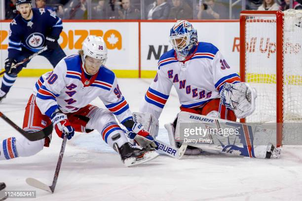 Vladislav Namestnikov of the New York Rangers tries to block a shot in front of goaltender Henrik Lundqvist during third period action against the...