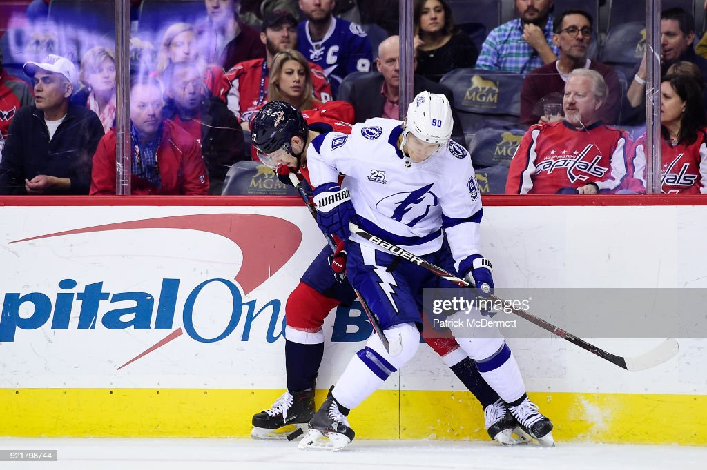 Vladislav Namestnikov #90 of the Tampa Bay Lightning and Evgeny Kuznetsov #92 of the Washington Capitals battle for the puck in the first period at Capital One Arena on February 20, 2018 in Washington, DC.