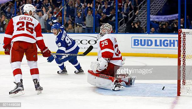 Vladislav Namestnikov of the Tampa Bay Lightning celebrates a goal as Mike Green and Jimmy Howard of the Detroit Red Wings react during the second...