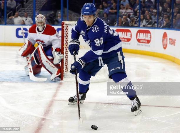 Vladislav Namestnikov of the Tampa Bay Lightning controls the puck as Carey Price of the Montreal Canadiens looks on during the second period at...