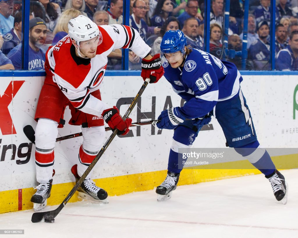 Vladislav Namestnikov #90 of the Tampa Bay Lightning skates against Brett Pesce #22 of the Carolina Hurricanes during the third period at Amalie Arena on January 9, 2018 in Tampa, Florida.
