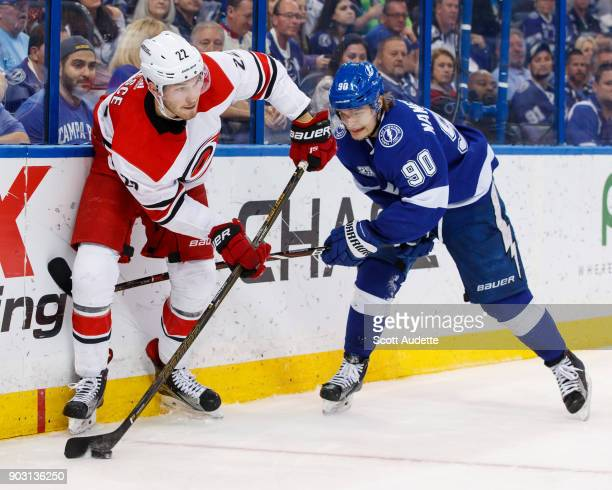 Vladislav Namestnikov of the Tampa Bay Lightning skates against Brett Pesce of the Carolina Hurricanes during the third period at Amalie Arena on...