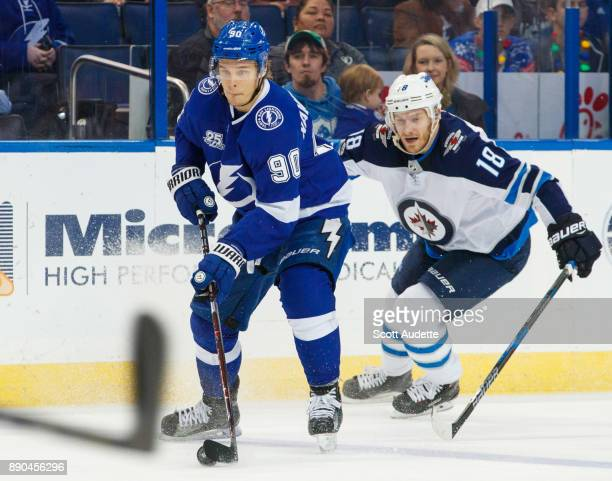 Vladislav Namestnikov of the Tampa Bay Lightning skates against Bryan Little of the Winnipeg Jets during the second period at Amalie Arena on...